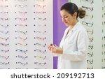 optical store  posing woman... | Shutterstock . vector #209192713