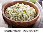 Green Rice With Herbs In Woode...