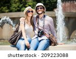 couple of young tourists... | Shutterstock . vector #209223088