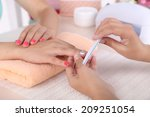 young woman is getting manicure ... | Shutterstock . vector #209251054