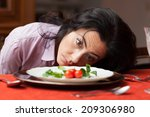 woman looking to a little salad ... | Shutterstock . vector #209306980