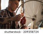 Young Man Working In A Biking...