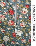 zipper on flowers pattern cloth | Shutterstock . vector #209378029