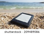 e book reader on a beach with... | Shutterstock . vector #209489086