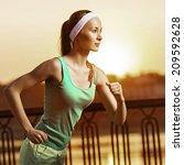 running woman. runner is... | Shutterstock . vector #209592628