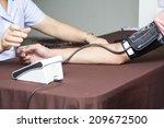 blood pressure measuring | Shutterstock . vector #209672500