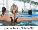 female fitness class doing aqua ... | Shutterstock . vector #209676688