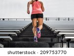 young fit female athlete... | Shutterstock . vector #209753770