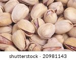 Salted pistachio closeup background. - stock photo