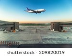 Airplane Flying Over Airport