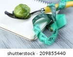 notebook with measuring tape... | Shutterstock . vector #209855440