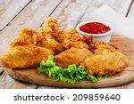fried chicken wings in batter  | Shutterstock . vector #209859640