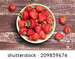 Strawberry In A Bowl On Wooden...