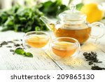 green tea in cup and teapot on... | Shutterstock . vector #209865130