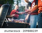 tailgate  man works the grill... | Shutterstock . vector #209888239