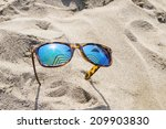 Sunglasses On Beach Sand Which...