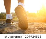 athlete runner feet running on... | Shutterstock . vector #209924518