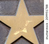 Small photo of Detail of a bronze star symbol.