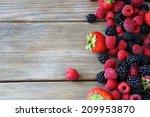 summer berries on wooden... | Shutterstock . vector #209953870