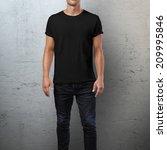 man wearing black t shirt.... | Shutterstock . vector #209995846