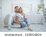 loving couple in a bright room   Shutterstock . vector #210014824