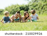 happy young family with little... | Shutterstock . vector #210029926