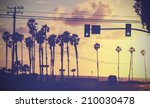 vintage sunset picture of palms ...   Shutterstock . vector #210030478