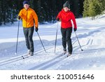 young couple doing cc skiing   Shutterstock . vector #210051646