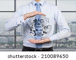 Small photo of Businessman is holding the flow chart and trying to imply it into a new start up project.