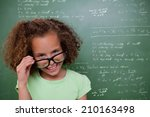 Small photo of Cute pupil tilting glasses against rocket science theory