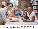 cute pupils and teacher reading ... | Shutterstock . vector #210167614