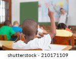 pupil raising hand in classroom ... | Shutterstock . vector #210171109