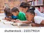 cute pupils and teacher lying... | Shutterstock . vector #210179014