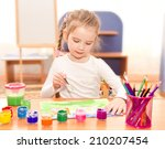 cute little girl drawing with... | Shutterstock . vector #210207454