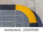 corner of footpath painted... | Shutterstock . vector #210259309