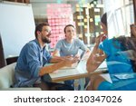 young business partners sharing ... | Shutterstock . vector #210347026