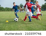 boys kicking football on the... | Shutterstock . vector #210359746