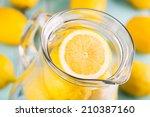 lemonade. fresh lemons in the... | Shutterstock . vector #210387160