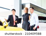 asian couple buying car in auto ... | Shutterstock . vector #210409588