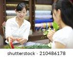 the female clerk in the flower... | Shutterstock . vector #210486178