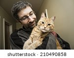Man Holding His Ginger Cat