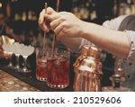 bartender is stirring cocktails ... | Shutterstock . vector #210529606