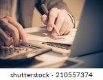 businessman analyzing... | Shutterstock . vector #210557374