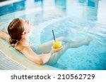 Woman Enjoying In Swimming Poo...