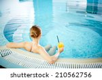 Young Woman Sitting In Swimming ...