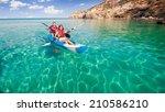 sailing on the sea kayaking.... | Shutterstock . vector #210586210
