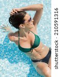 young woman in the pool | Shutterstock . vector #210591316