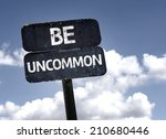 Be Uncommon Sign With Clouds...