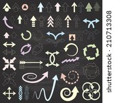 arrows drawn with crayons on... | Shutterstock .eps vector #210713308