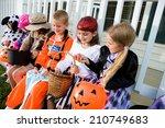 Halloween  kids sit on porch...